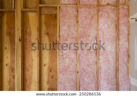 Horizontal Close Up of Fiberglass Installation in New Home Construction - stock photo