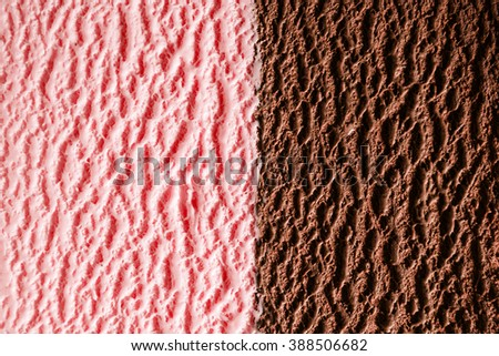 Horizontal close up of fine strawberry and chocolate fudge flavor ice cream with delicious texture - stock photo