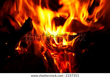 Horizontal close-up of flames and fire on a black background - stock photo