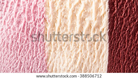 Horizontal close up of strawberry, chocolate fudge and vanilla flavor ice cream with delicious texture - stock photo