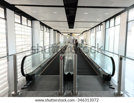 Horizontal escalator toward way and backward way - stock photo