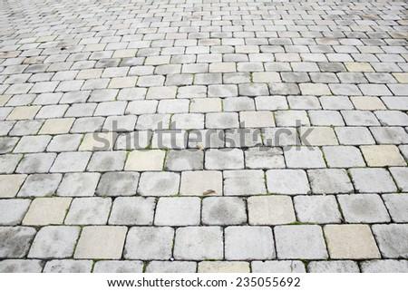 Horizontal floor tiles in urban street - stock photo
