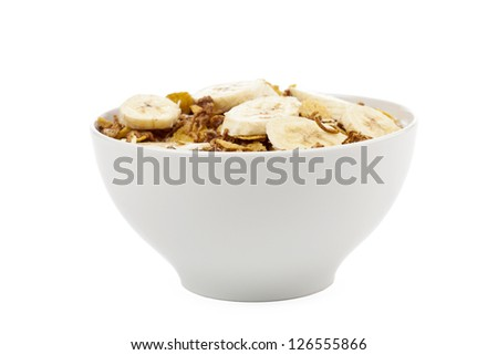 Horizontal image of a bowl filled with corn cereals and banana slices isolated in a white background - stock photo