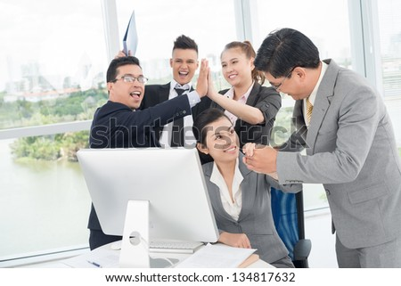 Horizontal image of a businessman congratulate his colleagues - stock photo