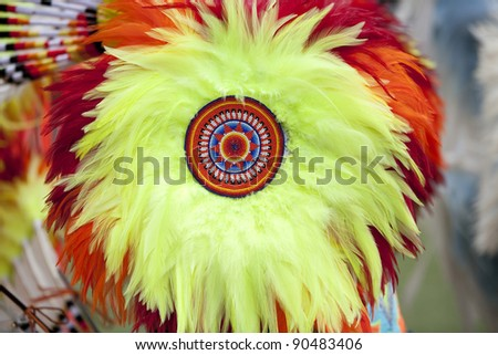 Horizontal image of a feather bustle with detailed beadwork at an American Indian Pow Wow. - stock photo