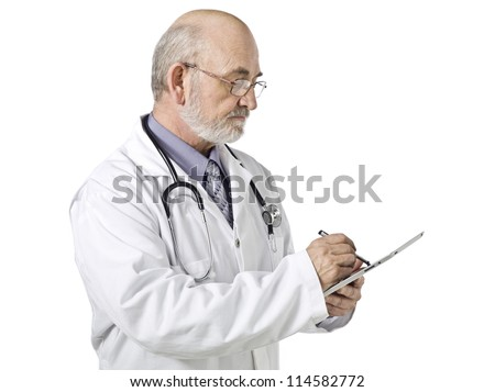 Horizontal image of a senior male doctor busy doing a paper work - stock photo