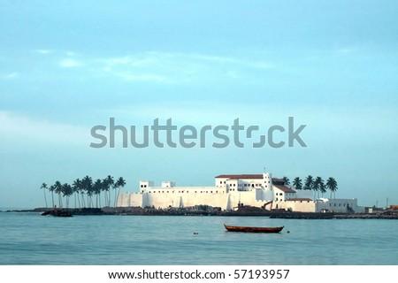 Horizontal image of Elmina Castle across the water - stock photo