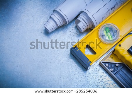 Horizontal image of measuring line construction plans and level square ruler on metallic background maintenance concept. - stock photo