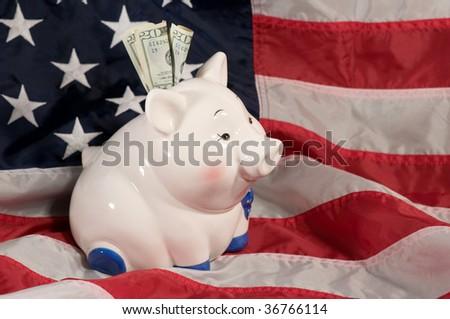 horizontal image of piggy bank on an American flag - stock photo