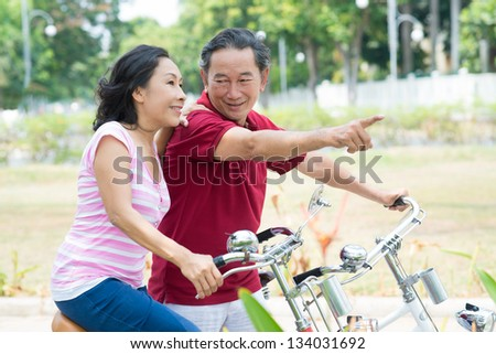 Horizontal image of seniors choosing their way - stock photo