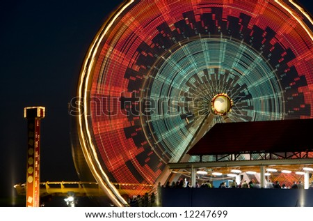 Horizontal image of the Pacific Wheel, recently sold at auction, at the Santa Monica Pier amusement park. - stock photo