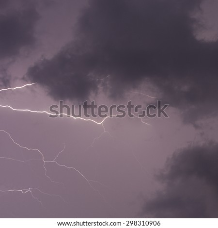 Horizontal lightning strikes in the night with clouds - stock photo