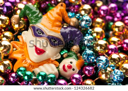 Horizontal of Colorful, Plastic Mardi Gras Beads with Jester Text or Copy Space - stock photo