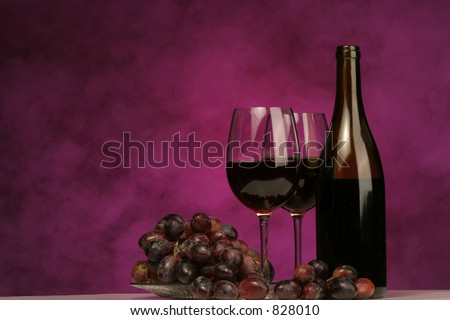 Horizontal of Wine bottle with glasses and grapes on purple background - stock photo