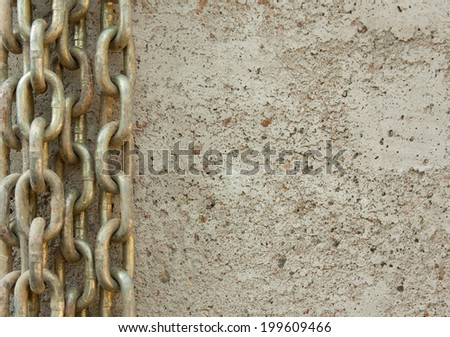 horizontal orientation close up of several chains on a concrete background with copy space / Overcoming Chains - Horizontal - stock photo