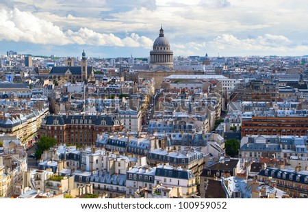 Horizontal panorama of the top view of one of the towers of Notre Dame in a usual summer day. In the background is seen Pantheon of Paris. - stock photo