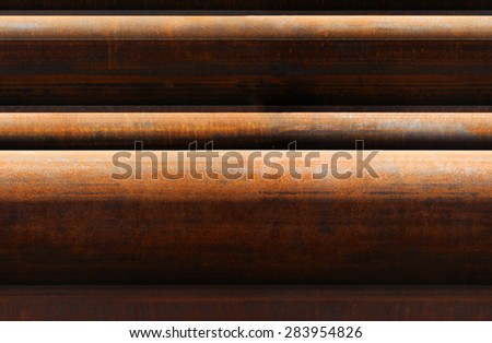 horizontal pattern of rusty pipes closeup - stock photo