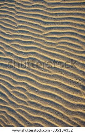 Horizontal pattern of wind blown sand ripples. - stock photo