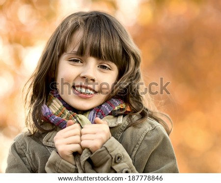 horizontal photo, happy beautiful little girl , autumnal portrait - stock photo