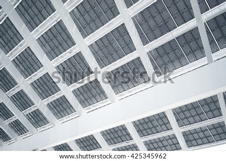 Horizontal Photo Modern Solar Panel with Sunrays Reflecting. Contemporary Building Architecture. Empty Abstract background  - stock photo