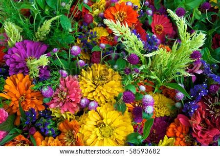 Horizontal photo of just picked summer flowers at local farm market - stock photo