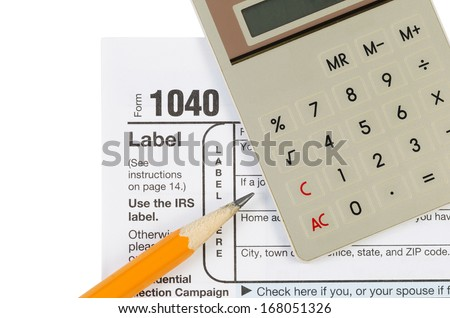 Horizontal photo of United States Tax Form 1040 for Individual Income with Calculator and pencil isolated on white  - stock photo