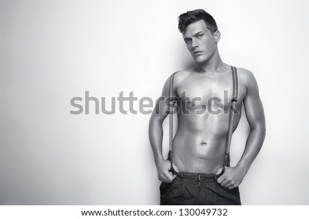Horizontal portrait of a sexy man shirtless - black and white - stock photo