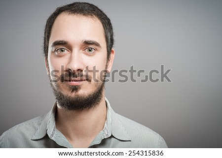 Horizontal portrait of a young handsome caucasian man smiling. Male model looking at camera. Copy space friendly face - stock photo