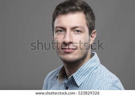 Horizontal portrait of confident young successful ceo looking at camera