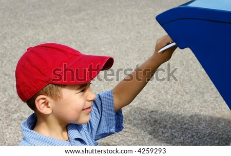 Horizontal scene of a young boy posting a letter - stock photo