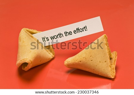 Horizontal Shot Fortune Cookie Saying, 'Worth The Effort Fortune Cookie' - stock photo