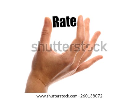 "Horizontal shot of a hand holding the word ""Rate"" between two fingers, isolated on white."