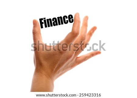 "Horizontal shot of a hand squeezing the word ""Finance"" between two fingers, isolated on white. - stock photo"