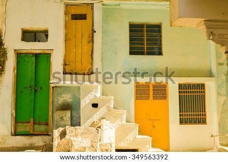 Horizontal shot of an old building with colorful doors in the afternoon sun. This was shot in the old city in Udaipur, India.  - stock photo