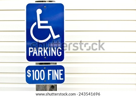 Horizontal Shot Of Handicap Reserved Parking Sign With Fine Copy Space - stock photo