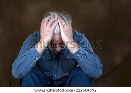 Horizontal Shot Of Man In Despair/ Man In Despair - stock photo