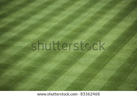 Horizontal shot of manicured outfield grass at a baseball stadium. - stock photo