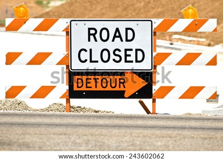 Horizontal Shot Of 'Road Closed' Barrier With Detour Sign - stock photo
