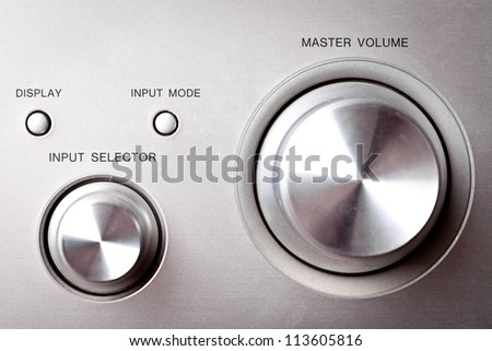 Horizontal shot of some Hi-Fi knobs from a stereo amplifier