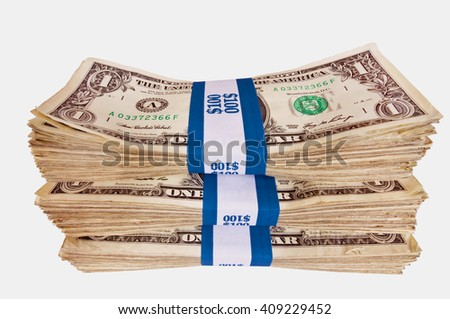 Horizontal shot of stacks of bills shot at a slight angle so they cannot be copied or duplicated/ Stacks Of Cash Isolated - stock photo