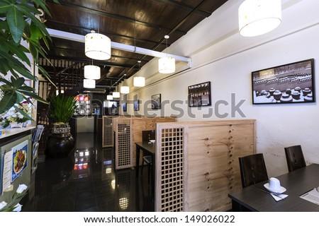 Horizontal shot of the interior of a Korean Restaurant. - stock photo