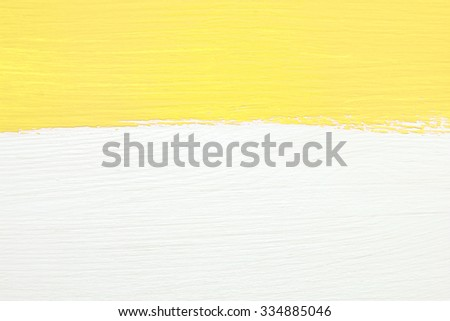 Horizontal stripe of yellow paint over white painted wooden background - stock photo
