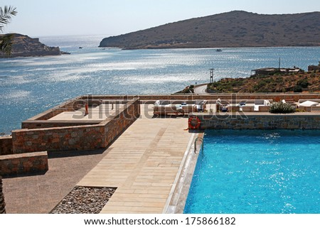 Horizontal summer landscape with Mediterranean sea, pool and terrace in luxury resort (Greece) - stock photo