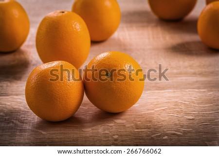 horizontal version fresh ripe tasty orange fruits on wooden board  - stock photo