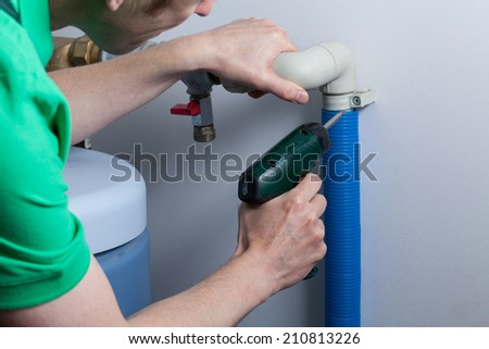 Horizontal view of a plumber during work