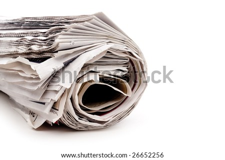 Horizontal view of a rolled up newspaper on white - stock photo