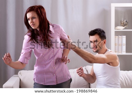 Horizontal view of a violence in young marriage
