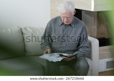 Horizontal view of elder man in bankrupt - stock photo