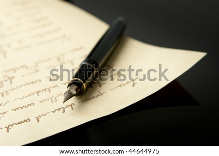 Horizontal view of Fountain Pen and Letter with extreme shallow depth of field. Focus on very end of nib on pen. - stock photo