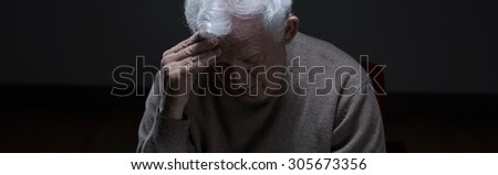 Horizontal view of hopeless senior man - panorama - stock photo